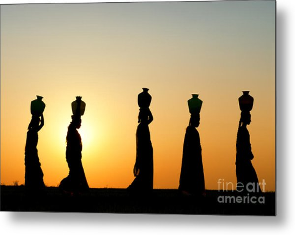 Indian Women Carrying Water Pots At Sunset Metal Print