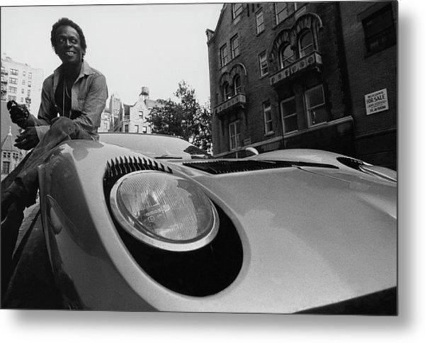 Jazz Musician Miles Davis Sitting On The Hood Metal Print