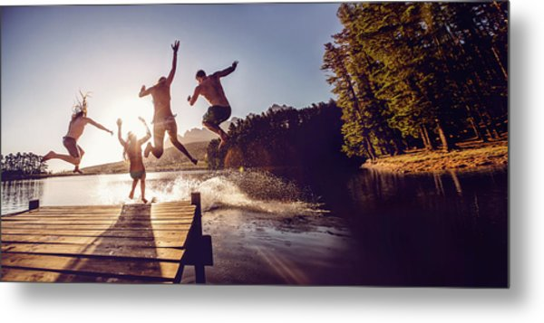 Jumping Into The Water From A Jetty Metal Print by Wundervisuals