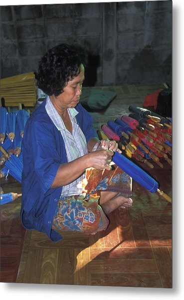 Lady Makes Umbrellas At A Factory Near Chaing Mai Metal Print by Richard Berry