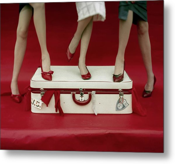 Legs Of Models Standing On A Suitcase Metal Print by Sante Forlano
