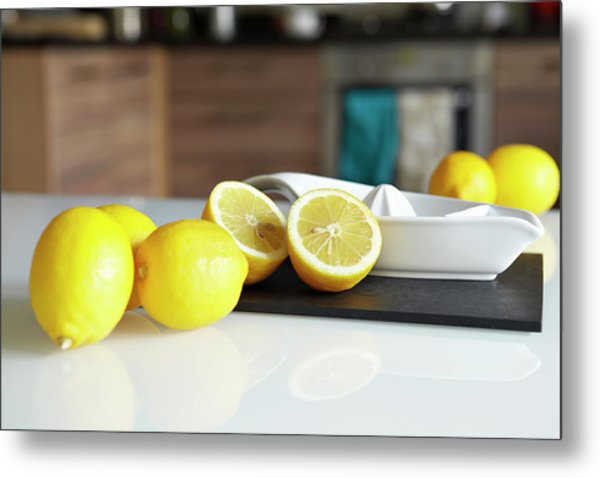 Lemons And Juicer On Kitchen Counter Metal Print by Debby Lewis-harrison