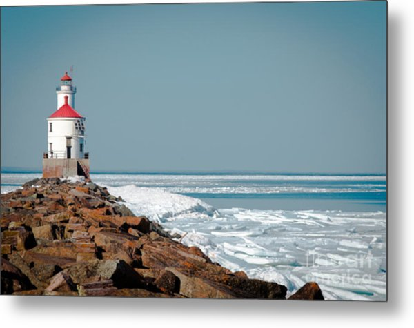 Lighthouse On Stone And Ice Metal Print