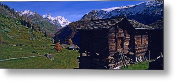 Log Cabins On A Landscape, Matterhorn Metal Print