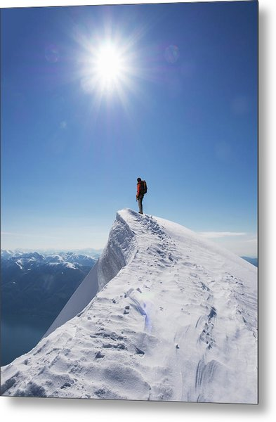 Lone Climber On The Top Of A  Mountain Metal Print by Buena Vista Images