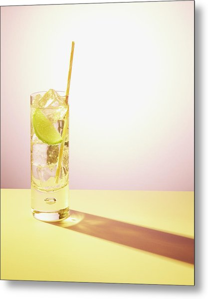 Long Drink In Glass With Lime And Straw Metal Print by Felicity Mccabe