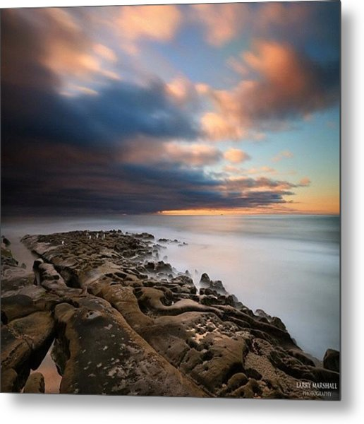 Long Exposure Sunset Of An Incoming Metal Print by Larry Marshall