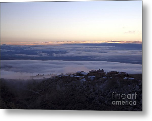 Low Lying Clouds In Waves Before Sunrise Over Jerome Arizona Metal Print
