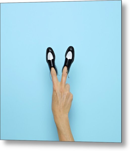 Making Peace Sign With Miniature Shoes Metal Print
