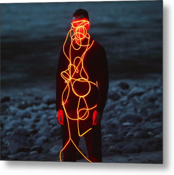 Man Entangled With Neon Wires Against Nature Background Metal Print by Vasilina Popova