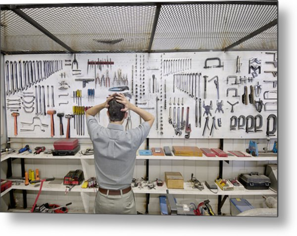 Man Holding Head By Wall Of Tools Metal Print by Lester Lefkowitz