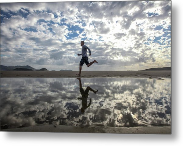 Man Running On Beach Metal Print by Paul Mansfield Photography
