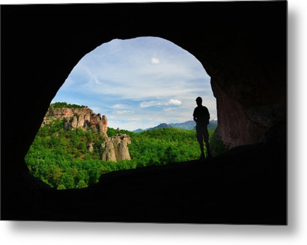 Man Watching The Landscape From The Inside Of A Cave by Maya Karkalicheva