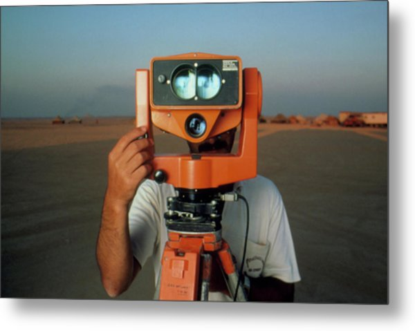 Man With A Survey Instrument In The Libyan Dessert Metal Print by Joe Pasieka/science Photo Library