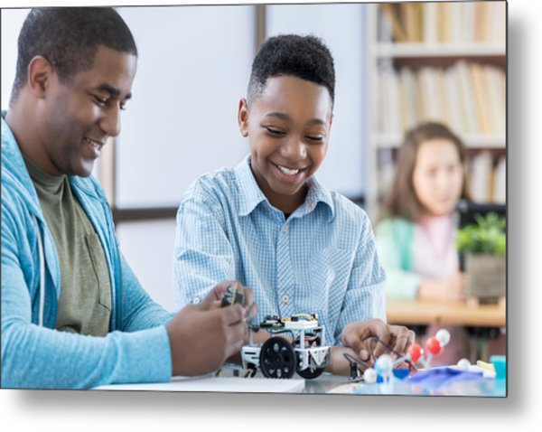 Mentor And Male Student Working Together On A Robot Metal Print by Steve Debenport