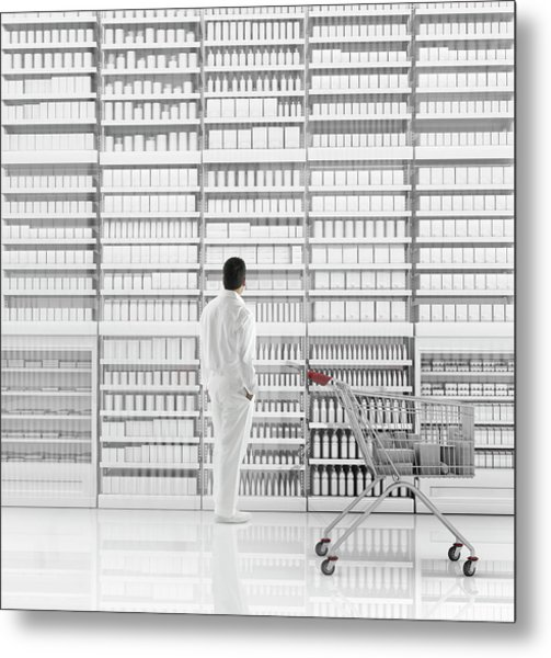 Mixed Race Man Shopping On White Metal Print by Colin Anderson Productions Pty Ltd