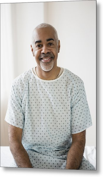Mixed Race Older Man Sitting On Hospital Bed Metal Print by JGI/Jamie Grill