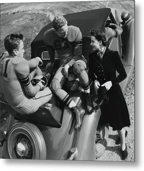 Model By Football Players On A Car Metal Print