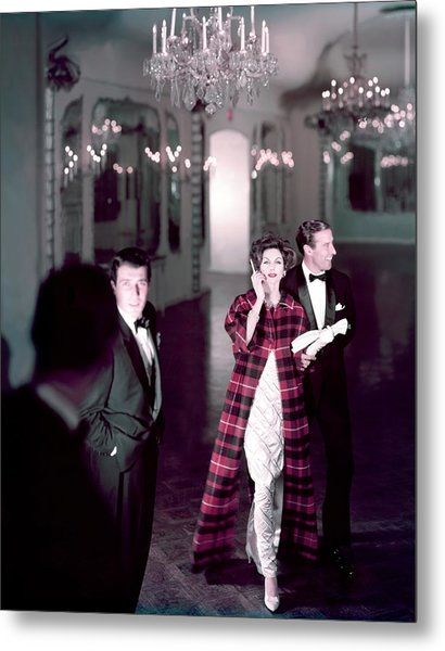 Model In Silver Dress Escorted By A Gentleman Metal Print