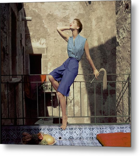 Model Wearing Blue Culottes And A Sea-green Shirt Metal Print by Henry Clarke