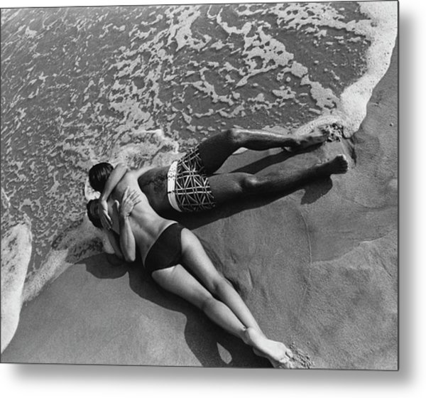Models Embracing On A Beach Metal Print