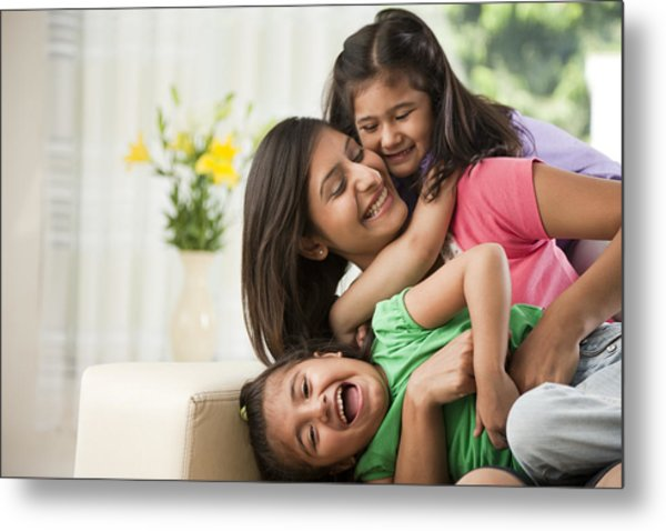 Mother With Daughters (6-7) Sitting On Sofa Metal Print by ImagesBazaar
