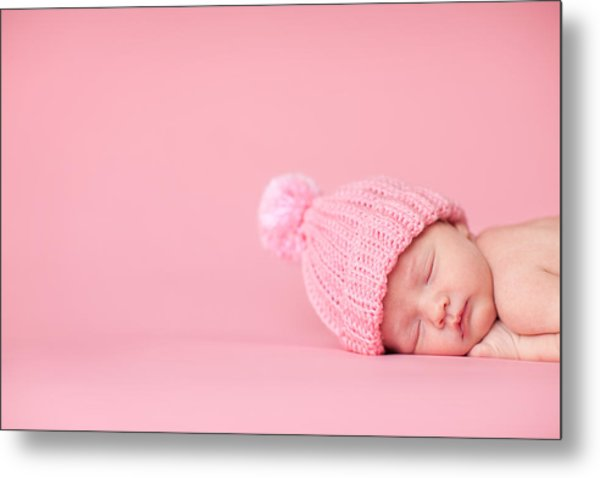 Newborn Baby Girl Sleeping Peacefully On Pink Background Metal Print by Ideabug