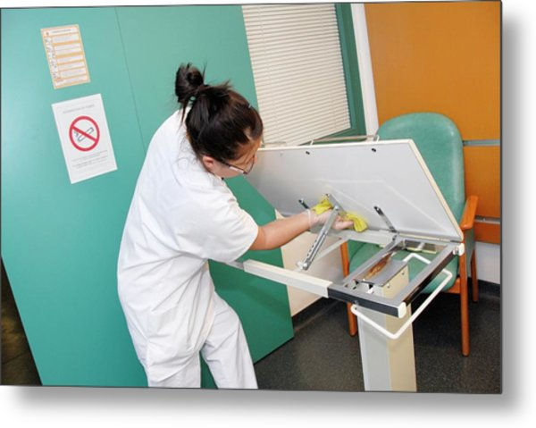 Nurse Cleaning Hospital Table Metal Print by Aj Photo/science Photo Library
