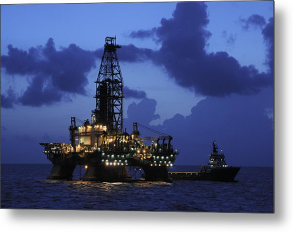 Oil Rig And Vessel At Night Metal Print