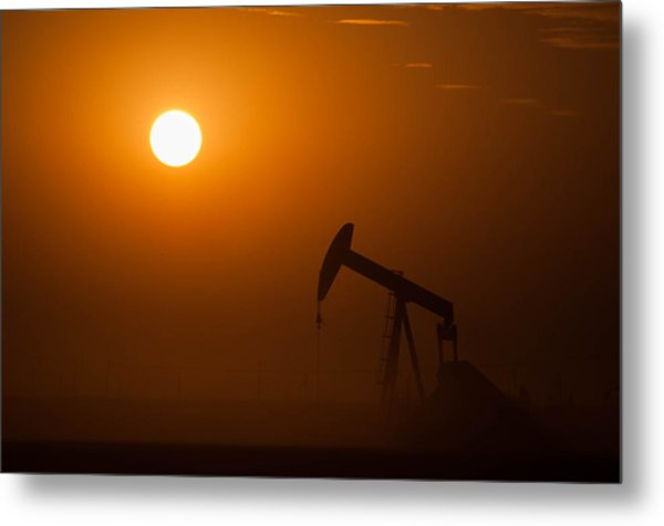Oil Rig Pumping At Sunset Metal Print by Connie Cooper-Edwards