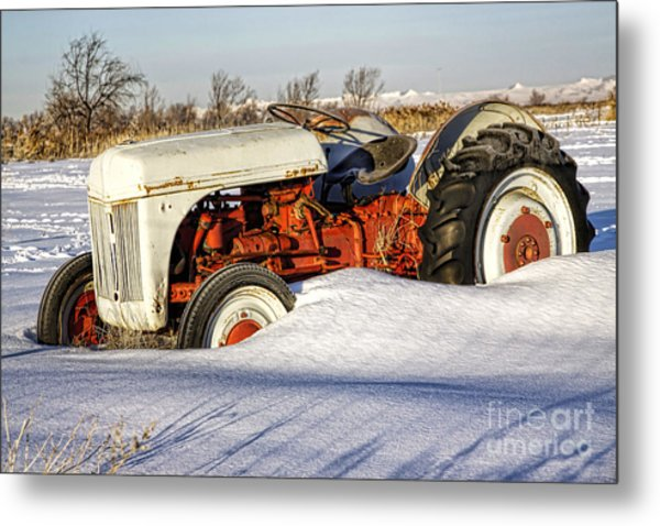 Old Tractor In The Snow Metal Print