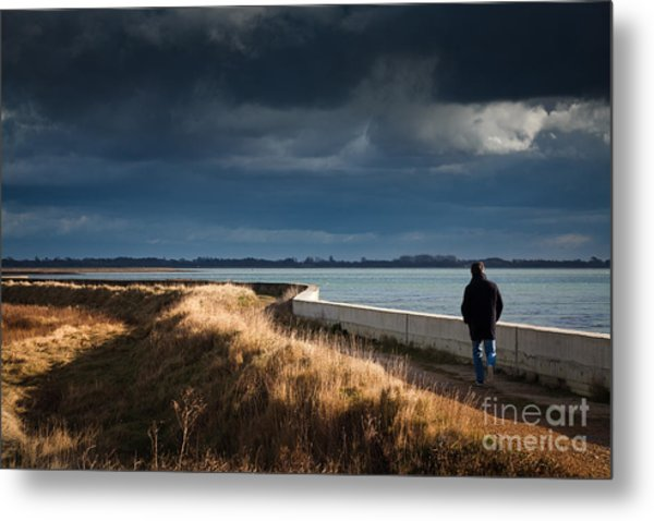 One Man Walking Alone By Sea Wall In Sunshine On Dramatic Stormy Metal Print