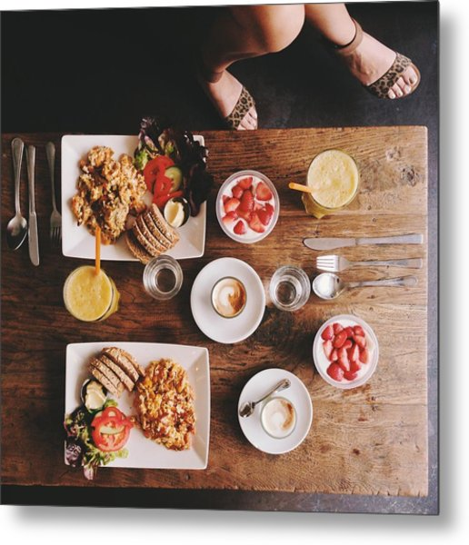Overhead View Of Woman's Legs And Breakfast Table Metal Print by Justhanni