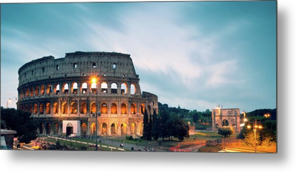 Panoramic Of The Colosseum At Night Metal Print by Matteo Colombo