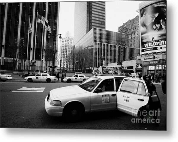Passenger Gets Out Of Rear Door Of Yellow Taxi Cab On 7th Avenue New York City Usa Metal Print by Joe Fox