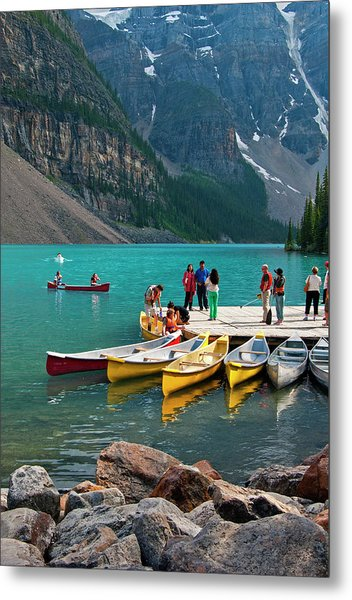 Passengers Renting Colourful Canoes On Metal Print by Emily Riddell