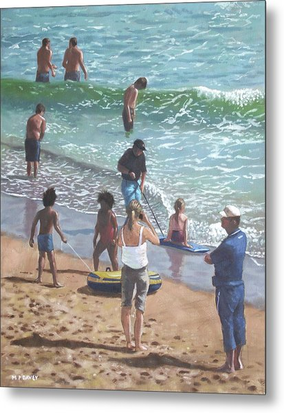 people on Bournemouth beach pulling dingys Metal Print