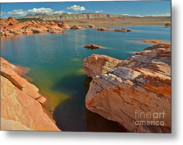 Pink Rocks Blue Water Metal Print