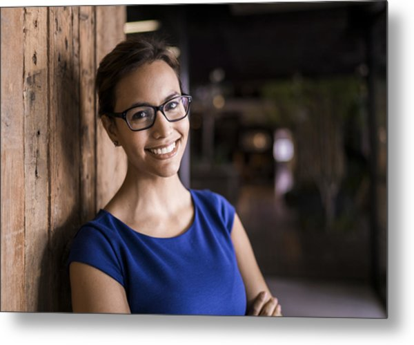 Portrait Of Confident Businesswoman Against Wooden Wall Metal Print by Portra