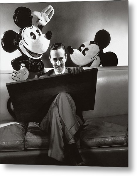 Portrait Of Walt Disney Sitting With Open Cartoon Metal Print by Edward Steichen