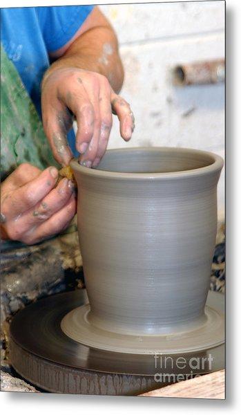 Potters Hands Metal Print