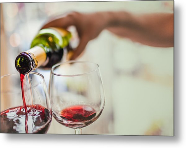 Pouring Red Wine In Glasses Metal Print by Instants