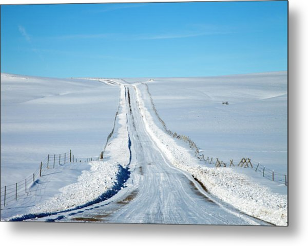 Pov Of Snow Covered Country Road Metal Print by Andrew Geiger