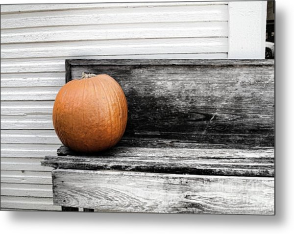 Pumpkin On A Bench Metal Print by Audreen Gieger