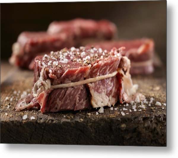 Raw Bacon Wrapped Steak Fillets Seasoned With Salt And Pepper Metal Print by Lauri Patterson