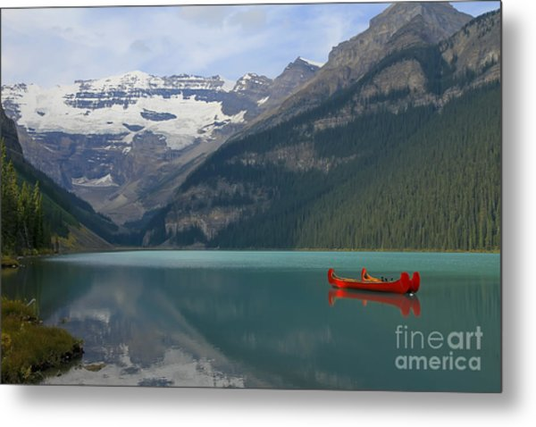 Red Canoes On Lake Louise Metal Print