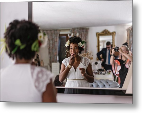 Reflection Of Bride Applying Lipstick While Standing In Front Of Mirror Metal Print by Adriana Duduleanu / EyeEm