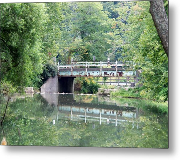 Reflections Of A Bridge Metal Print by Adam L