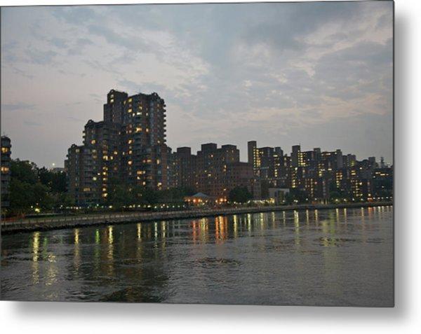 Residential Towers Near Water At Dusk Metal Print