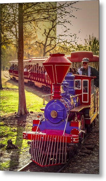 Riding Out Of The Sunset On The Hermann Park Train Metal Print
